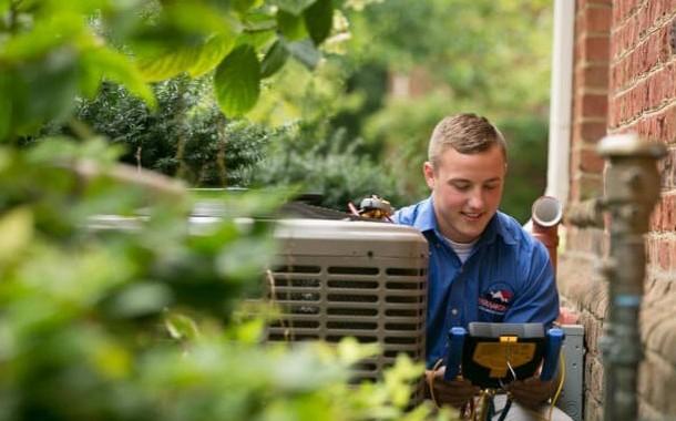HVAC-technician-checking-equipment-landscape